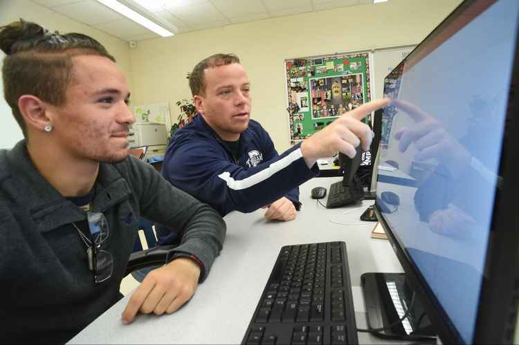 dave woodley and student looking at computer