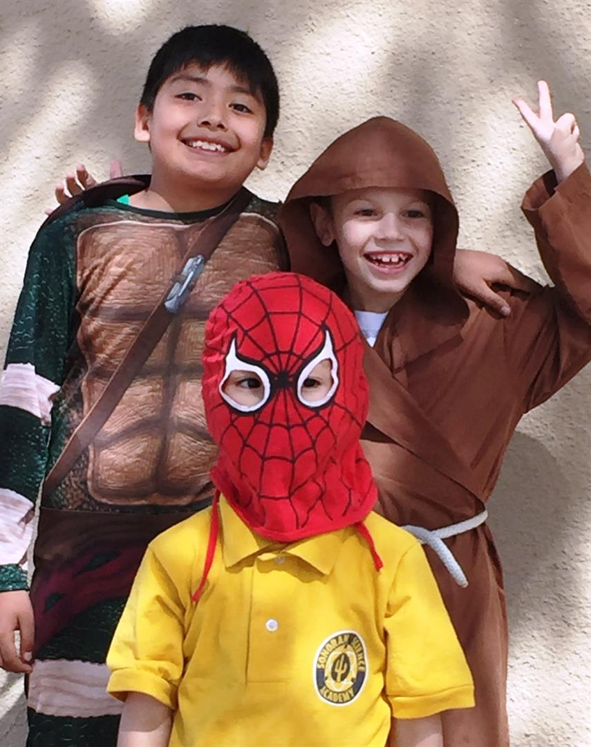 Three boys wearing costumes