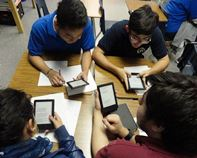 Overhead shot of boys with personal digital devices