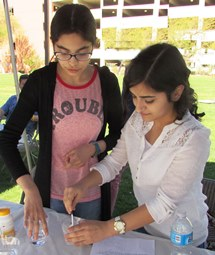 Two girls at expo with science project