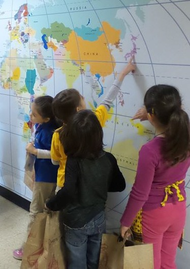 Students looking at world map