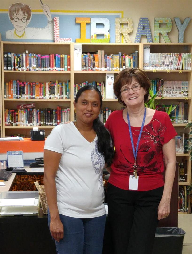 Two members of the library staff